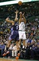 Apr 11, 2014; Boston, MA, USA; Boston Celtics guard Avery Bradley (0) makes a three point basket against Charlotte Bobcats guard Gerald Henderson (9) in the last minutes of play in the game at TD Garden. The Celtics defeated the Bobcats 106-103. Mandatory Credit: David Butler II-USA TODAY Sports