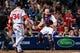 Apr 11, 2014; Atlanta, GA, USA; Atlanta Braves catcher Evan Gattis (24) looks for a past ball in the seventh inning against the Washington Nationals at Turner Field. Mandatory Credit: Daniel Shirey-USA TODAY Sports