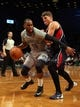 Apr 11, 2014; Brooklyn, NY, USA; Brooklyn Nets shooting guard Marcus Thornton (10) controls the ball against Atlanta Hawks shooting guard Kyle Korver (26) during the third quarter of a game at Barclays Center. The Hawks defeated the Nets 93-88. Mandatory Credit: Brad Penner-USA TODAY Sports