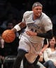 Apr 11, 2014; Brooklyn, NY, USA; Brooklyn Nets small forward Paul Pierce (34) controls the ball against the Atlanta Hawks during the third quarter of a game at Barclays Center. The Hawks defeated the Nets 93-88. Mandatory Credit: Brad Penner-USA TODAY Sports