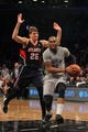 Apr 11, 2014; Brooklyn, NY, USA; Brooklyn Nets shooting guard Marcus Thornton (10) drives on Atlanta Hawks shooting guard Kyle Korver (26) during the fourth quarter of a game at Barclays Center. The Hawks defeated the Nets 93-88. Mandatory Credit: Brad Penner-USA TODAY Sports