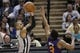 Apr 11, 2014; San Antonio, TX, USA; San Antonio Spurs guard Patrick Mills (8) shoots the ball over Phoenix Suns guard Ish Smith (3) during the second half at AT&T Center. The Spurs won 112-104. Mandatory Credit: Soobum Im-USA TODAY Sports
