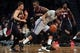 Apr 11, 2014; Brooklyn, NY, USA; Brooklyn Nets shooting guard Marcus Thornton (10) controls the ball against Atlanta Hawks power forward Paul Millsap (4) during the second quarter of a game at Barclays Center. Mandatory Credit: Brad Penner-USA TODAY Sports