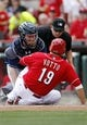Apr 12, 2014; Cincinnati, OH, USA; Cincinnati Reds first baseman Joey Votto (19) is tagged out during the fourth inning by the Tampa Bay Rays catcher Ryan Hanigan (24) at Great American Ball Park. Mandatory Credit: Frank Victores-USA TODAY Sports