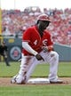 Apr 12, 2014; Cincinnati, OH, USA; Cincinnati Reds second baseman Brandon Phillips (4) reacts after being called out stealing third base during the fourth inning against the Tampa Bay Rays at Great American Ball Park. Mandatory Credit: Frank Victores-USA TODAY Sports