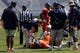 Apr 12, 2014; Charlottesville, VA, USA; Virginia Cavaliers head coach Mike London (left) looks on as trainers attend to Cavaliers offensive tackle Cody Wallace (61) after being injured during the Cavaliers Spring Game at Scott Stadium. Mandatory Credit: Geoff Burke-USA TODAY Sports