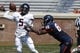 Apr 12, 2014; Charlottesville, VA, USA; Virginia Cavaliers quarterback David Watford (5) is tackled by Cavaliers defensive end Max Valles (88) while attempting to throw the ball during the Cavaliers Spring Game at Scott Stadium. Mandatory Credit: Geoff Burke-USA TODAY Sports