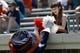 """Apr 12, 2014; Charlottesville, VA, USA; Virginia Cavaliers mascot """"CavMan"""" hands pom poms to a young fan in the stands during the Cavaliers Spring Game at Scott Stadium. Mandatory Credit: Geoff Burke-USA TODAY Sports"""