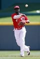 Apr 12, 2014; Cincinnati, OH, USA; Cincinnati Reds second baseman Brandon Phillips (4) makes a play during the second inning against the Tampa Bay Rays at Great American Ball Park. Tampa defeated Cincinnati 1-0. Mandatory Credit: Frank Victores-USA TODAY Sports