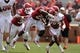 Apr 12, 2014; Norman, OK, USA; Oklahoma Sooners running back Keith Ford (21) runs the ball before being tackled by Sooners cornerback Dakota Austin (27) during the spring game at Gaylord Family Oklahoma Memorial Stadium. Mandatory Credit: Mark D. Smith-USA TODAY Sports
