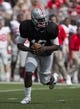 Apr 12, 2014; Columbus, OH, USA; Ohio State scarlet team quarterback Cardale Jones (12) runs around the outside during the Ohio State Buckeyes spring game at Ohio Stadium. The scarlet team won the game 17-7. Mandatory Credit: Greg Bartram-USA TODAY Sports