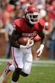 Apr 12, 2014; Norman, OK, USA; Oklahoma Sooners running back Keith Ford (21) runs the ball during the spring game at Gaylord Family Oklahoma Memorial Stadium. Mandatory Credit: Mark D. Smith-USA TODAY Sports