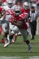 Apr 12, 2014; Columbus, OH, USA; Ohio State Scarlet Team wide receiver Corey Smith (84) runs with the ball upfield during the Ohio State Buckeyes Spring Game at Ohio Stadium. The Scarlet team won 17-7. Mandatory Credit: Greg Bartram-USA TODAY Sports