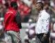 Apr 12, 2014; Columbus, OH, USA Ohio State Buckeyes head coach Urban Meyer talks with quarterback Braxton Mille prior to the Ohio State Buckeyes Spring Game at Ohio Stadium. The Scarlet team won 17-7. Mandatory Credit: Greg Bartram-USA TODAY Sports