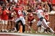Apr 12, 2014; Norman, OK, USA; Oklahoma Sooners wide receiver Austin Bennett (8) catches a touchdown pass while being chased by Sooners cornerback Brandon Yound (39) during the spring game at Gaylord Family Oklahoma Memorial Stadium. Mandatory Credit: Mark D. Smith-USA TODAY Sports