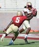 Apr 12, 2014; Tallahassee, FL, USA; Florida State Seminoles wide receiver Jared Haggins (12) catches a touchdown pass past linebacker Reggie Northrup (5) during the spring game at Doak Campbell Stadium. Mandatory Credit: Melina Vastola-USA TODAY Sports