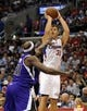 Apr 12, 2014; Los Angeles, CA, USA; Los Angeles Clippers forward Blake Griffin (32) attempts a shot defended by Sacramento Kings forward Reggie Evans (30) during the third quarter at Staples Center. The Los Angeles Clippers won 117-101. Mandatory Credit: Kelvin Kuo-USA TODAY Sports