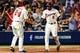 Apr 12, 2014; Atlanta, GA, USA; Atlanta Braves left fielder Justin Upton (8) celebrates scoring with catcher Evan Gattis (24) in the fifth inning against the Washington Nationals at Turner Field. Mandatory Credit: Daniel Shirey-USA TODAY Sports