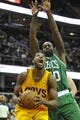 Apr 12, 2014; Cleveland, OH, USA; Cleveland Cavaliers forward Tristan Thompson (left) looks to shoot against Boston Celtics forward Brandon Bass (30) in the fourth quarter at Quicken Loans Arena. Mandatory Credit: David Richard-USA TODAY Sports
