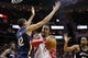 Apr 12, 2014; Houston, TX, USA; Houston Rockets center Dwight Howard (12) attempts to shoot while defended by New Orleans Pelicans center Alexis Ajinca (42) during the second half at Toyota Center. The Rockets won 111-104. Mandatory Credit: Soobum Im-USA TODAY Sports