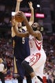 Apr 12, 2014; Houston, TX, USA; Houston Rockets guard James Harden (13) drives to the basket under pressure from New Orleans Pelicans center Jeff Withey (5) during the second half at Toyota Center. The Rockets won 111-104. Mandatory Credit: Soobum Im-USA TODAY Sports