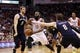 Apr 12, 2014; Houston, TX, USA; Houston Rockets guard James Harden (13) drives for the basket between New Orleans Pelicans center Jeff Withey (5) and forward Luke Babbitt (8) during the second half at Toyota Center. The Rockets won 111-104. Mandatory Credit: Soobum Im-USA TODAY Sports