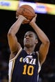 Apr 6, 2014; Oakland, CA, USA; Utah Jazz guard Alec Burks (10) shoots a free throw against the Golden State Warriors during the third quarter at Oracle Arena. The Warriors defeated the Jazz 130-102. Mandatory Credit: Kyle Terada-USA TODAY Sports