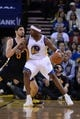 Apr 6, 2014; Oakland, CA, USA; Golden State Warriors center Jermaine O'Neal (7) dribbles the basketball against Utah Jazz center Enes Kanter (0) during the third quarter at Oracle Arena. The Warriors defeated the Jazz 130-102. Mandatory Credit: Kyle Terada-USA TODAY Sports