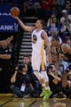Apr 6, 2014; Oakland, CA, USA; Golden State Warriors guard Stephen Curry (30) shoots the ball against the Utah Jazz during the third quarter at Oracle Arena. The Warriors defeated the Jazz 130-102. Mandatory Credit: Kyle Terada-USA TODAY Sports