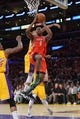Apr 8, 2014; Los Angeles, CA, USA; Houston Rockets forward Terrence Jones (6) shoots the ball against the Los Angeles Lakers at Staples Center. Mandatory Credit: Kirby Lee-USA TODAY Sports