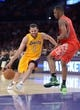 Apr 8, 2014; Los Angeles, CA, USA; Los Angeles Lakers guard Jordan Farmar (1) is defended by Houston Rockets forward Terrence Jones (6) at Staples Center. Mandatory Credit: Kirby Lee-USA TODAY Sports