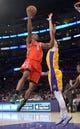 Apr 8, 2014; Los Angeles, CA, USA; Houston Rockets forward Terrence Jones (6) is defended by Los Angeles Lakers forward Ryan Kelly (4) at Staples Center. Mandatory Credit: Kirby Lee-USA TODAY Sports