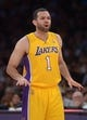 Apr 8, 2014; Los Angeles, CA, USA; Los Angeles Lakers guard Jordan Farmar (1) reacts during the game against the Houston Rockets at Staples Center. Mandatory Credit: Kirby Lee-USA TODAY Sports