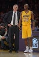 Apr 8, 2014; Los Angeles, CA, USA; Los Angeles Lakers coach Mike D'Antoni (left) and guard Jodie Meeks (20) during the game against the Houston Rockets at Staples Center. Mandatory Credit: Kirby Lee-USA TODAY Sports