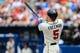 Apr 13, 2014; Atlanta, GA, USA; Atlanta Braves first baseman Freddie Freeman (5) hits a two run home run in the second inning against the Washington Nationals at Turner Field. Mandatory Credit: Daniel Shirey-USA TODAY Sports