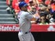 April 13, 2014; Anaheim, CA, USA; New York Mets third baseman David Wright (5) hits an RBI single in the first inning against the Los Angeles Angels at Angel Stadium of Anaheim. Mandatory Credit: Gary A. Vasquez-USA TODAY Sports