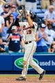 Apr 13, 2014; Atlanta, GA, USA; Atlanta Braves shortstop Andrelton Simmons (19) celebrates a three run home run in the eighth inning against the Washington Nationals at Turner Field. Mandatory Credit: Daniel Shirey-USA TODAY Sports