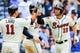 Apr 13, 2014; Atlanta, GA, USA; Atlanta Braves shortstop Andrelton Simmons (19) celebrates with teammates after a three run home run in the eighth inning against the Washington Nationals at Turner Field. Mandatory Credit: Daniel Shirey-USA TODAY Sports