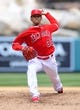 April 13, 2014; Anaheim, CA, USA; Los Angeles Angels starting pitcher C.J. Wilson (33) pitches the fifth inning against the New York Mets at Angel Stadium of Anaheim. Mandatory Credit: Gary A. Vasquez-USA TODAY Sports