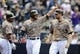 Apr 13, 2014; San Diego, CA, USA; San Diego Padres first baseman Yonder Alonso (23) and third baseman Chase Headley (right) after scoring during the fourth inning against the Detroit Tigers at Petco Park. Mandatory Credit: Christopher Hanewinckel-USA TODAY Sports