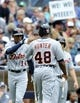 Apr 13, 2014; San Diego, CA, USA; Detroit Tigers right fielder Torii Hunter (48) is congratulated by center fielder Austin Jackson (14) after scoring during the fourth inning against the San Diego Padres at Petco Park. Mandatory Credit: Christopher Hanewinckel-USA TODAY Sports