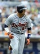Apr 13, 2014; San Diego, CA, USA; Detroit Tigers catcher Victor Martinez (41)hits an RBI single during the fourth inning against the San Diego Padres at Petco Park. Mandatory Credit: Christopher Hanewinckel-USA TODAY Sports