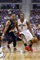 Apr 13, 2014; Auburn Hills, MI, USA; Toronto Raptors guard Kyle Lowry (7) dribbles around Detroit Pistons guard Peyton Siva (34) in the second quarter at The Palace of Auburn Hills. Mandatory Credit: Rick Osentoski-USA TODAY Sports