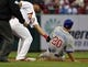 Apr 13, 2014; St. Louis, MO, USA; St. Louis Cardinals shortstop Jhonny Peralta (27) tags out Chicago Cubs left fielder Justin Ruggiano (20) on a stolen base attempt at Busch Stadium. Mandatory Credit: Scott Rovak-USA TODAY Sports