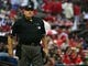 Apr 13, 2014; St. Louis, MO, USA; Umpire Jerry Layne (24) looks on during the third inning between the St. Louis Cardinals and the Chicago Cubs at Busch Stadium. Mandatory Credit: Scott Rovak-USA TODAY Sports