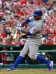 Apr 13, 2014; St. Louis, MO, USA; Chicago Cubs third baseman Luis Valbuena (24) puts the ball in play against the St. Louis Cardinals at Busch Stadium. The Cardinals defeated the Cubs 6-4. Mandatory Credit: Scott Rovak-USA TODAY Sports