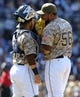 Apr 13, 2014; San Diego, CA, USA; San Diego Padres relief pitcher Joaquin Benoit (56) talks with catcher Rene Rivera (44) prior to the start of the eighth inning against the Detroit Tigers at Petco Park. Mandatory Credit: Christopher Hanewinckel-USA TODAY Sports
