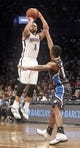 Apr 13, 2014; Brooklyn, NY, USA; Brooklyn Nets guard Deron Williams (8) puts up a shot against Orlando Magic guard Ronnie Price (10) in the fourth quarter at Barclays Center. Nets win 97-88. Mandatory Credit: Nicole Sweet-USA TODAY Sports