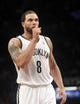 Apr 13, 2014; Brooklyn, NY, USA; Brooklyn Nets guard Deron Williams (8) at the free throw line against Orlando Magic in the fourth quarter at Barclays Center. Nets win 97-88. Mandatory Credit: Nicole Sweet-USA TODAY Sports