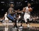 Apr 13, 2014; Brooklyn, NY, USA; Brooklyn Nets center Marcus Thornton (10) looks to pass the ball against Orlando Magic center Dewayne Dedmon (3) in the fourth quarter at Barclays Center. Nets win 97-88. Mandatory Credit: Nicole Sweet-USA TODAY Sports